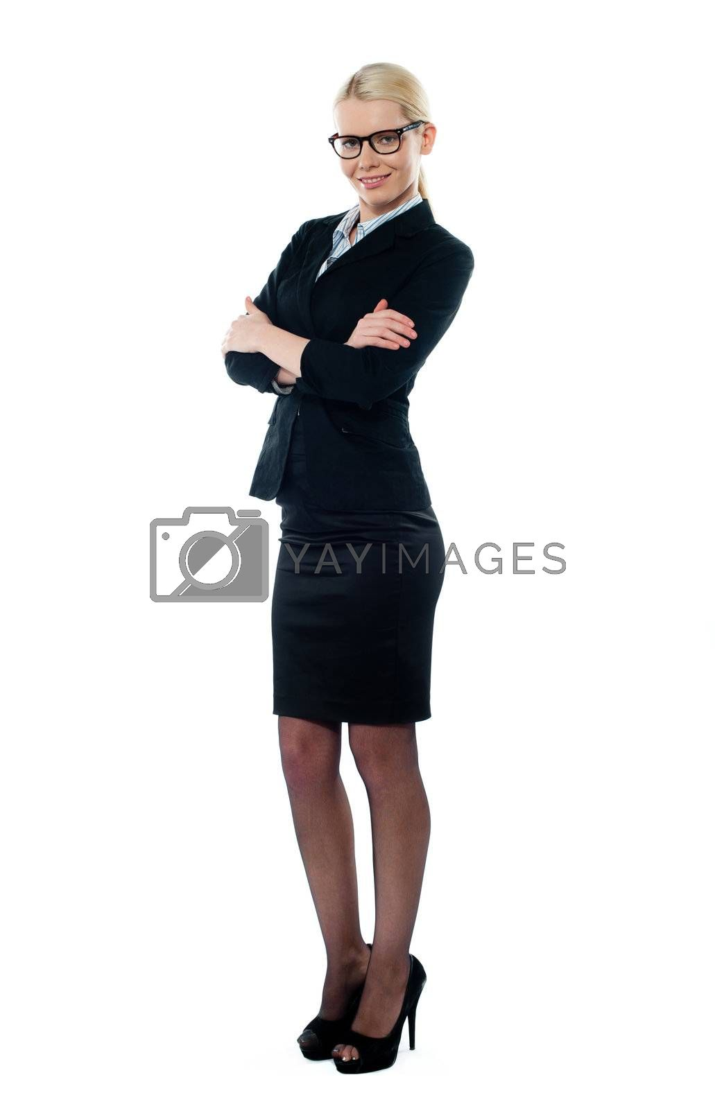 Full view welldessed corporate woman posing confidently in front of camera