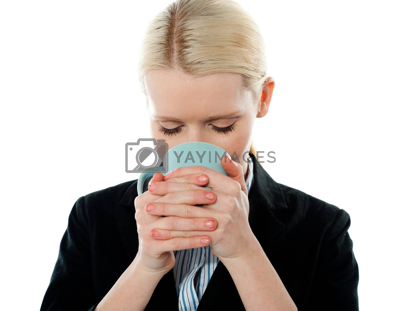 Businesswoman drinking coffee isolated on white