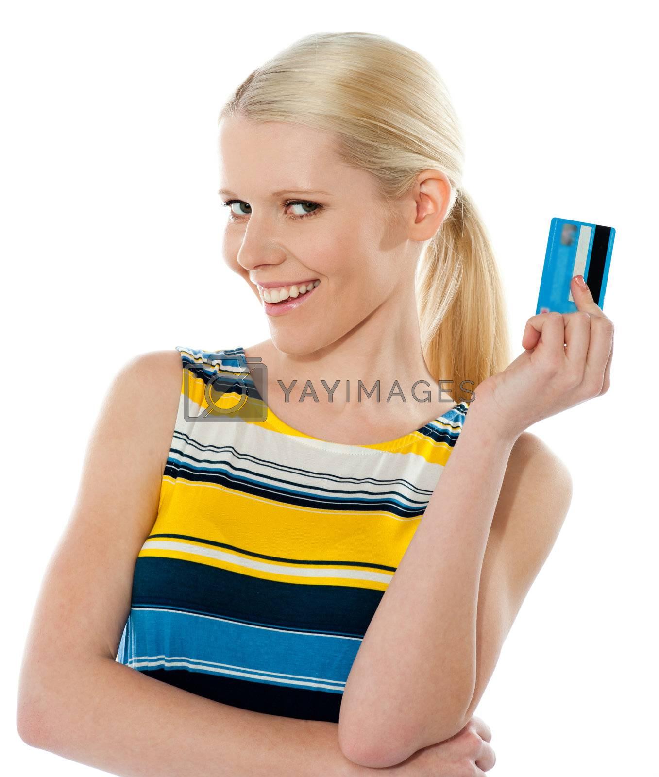 Blond salesgirl posing with credit card and smiling at camera