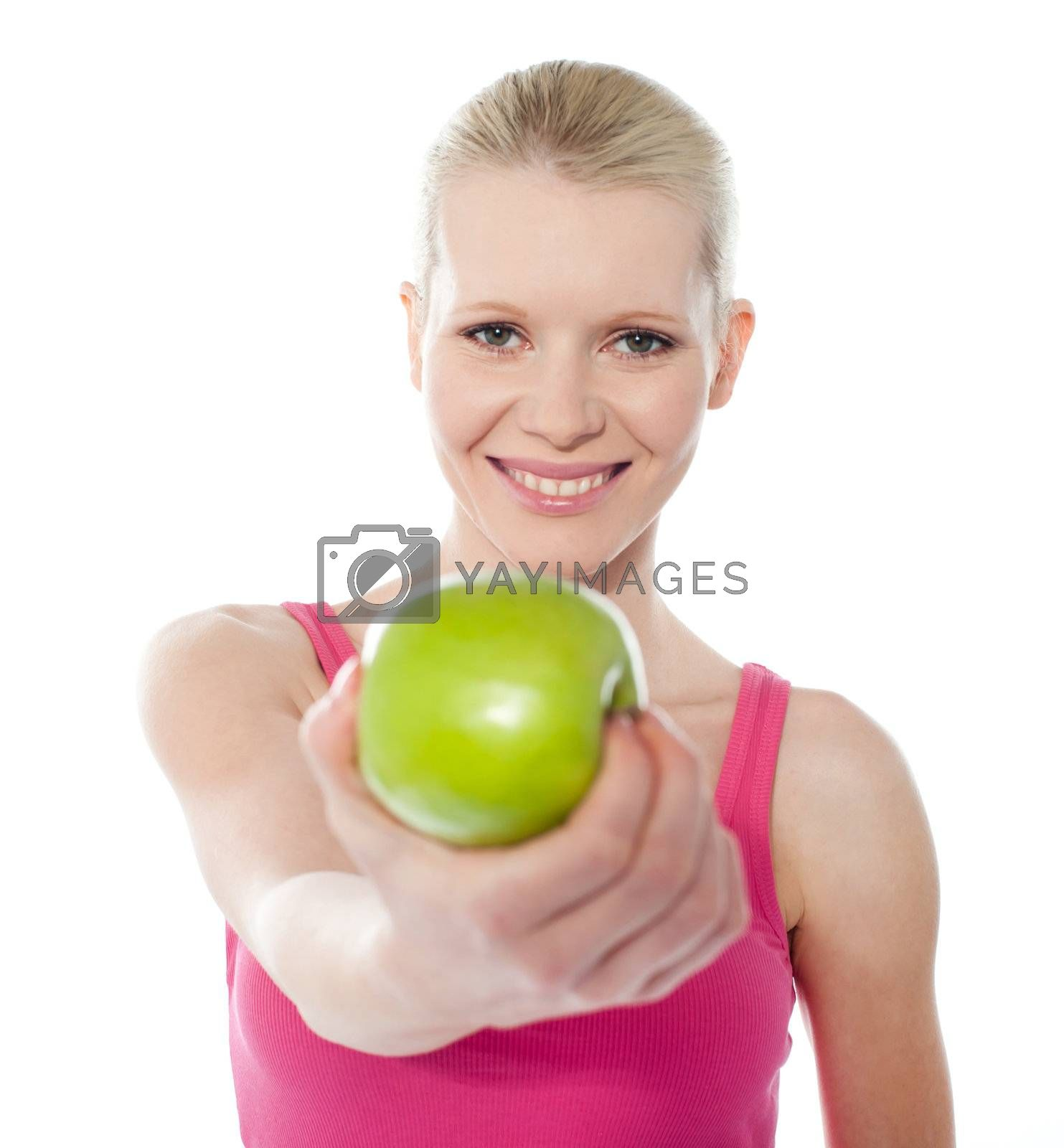 Teenager offering green apple, full of vitamins isolated on white