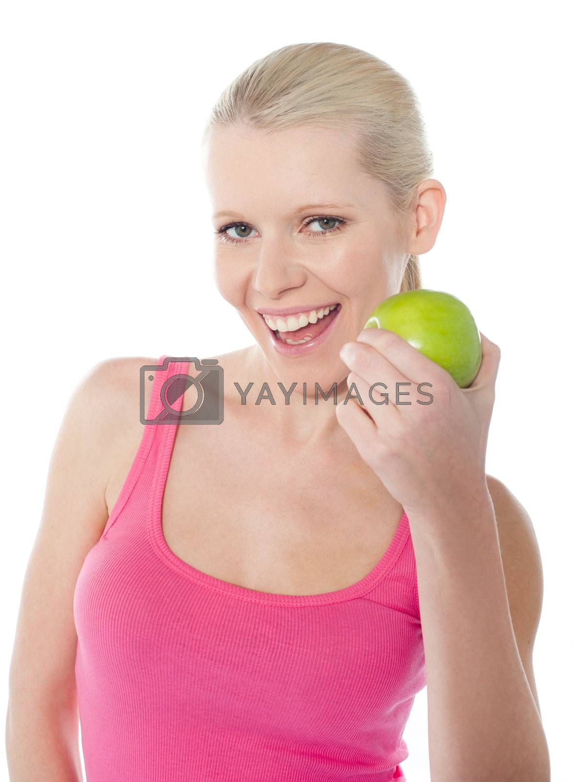Young caucasian girl holding green apple isolated on white background