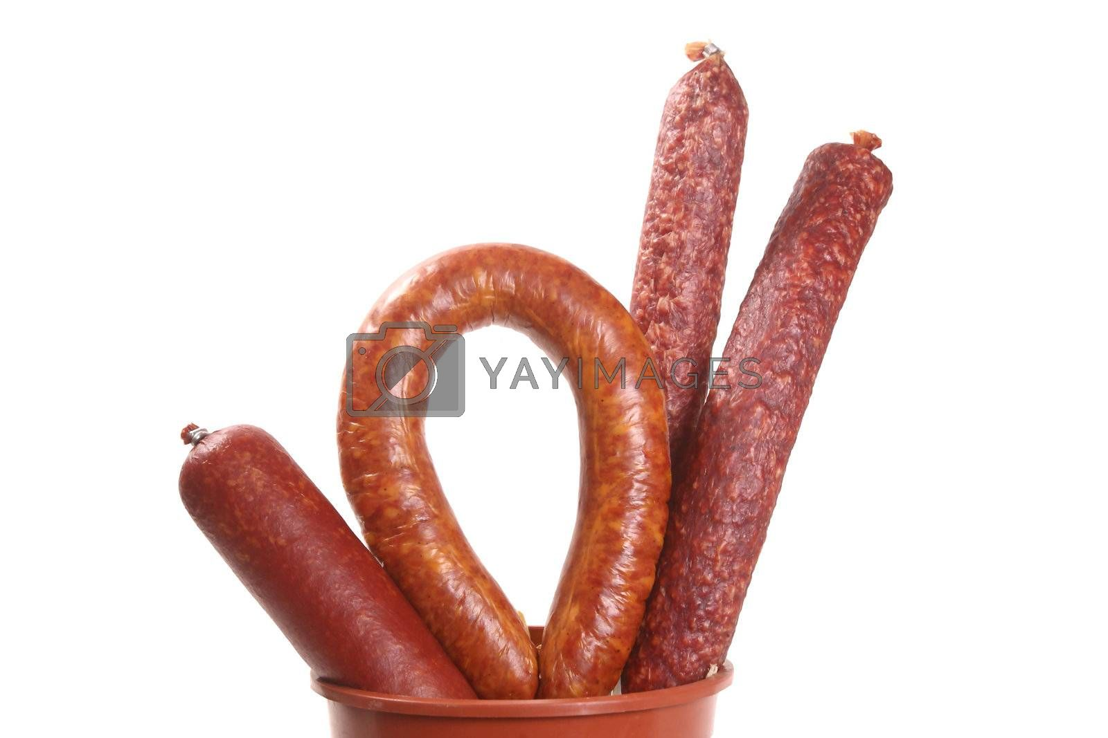 Assortiment of sausages isolated on white