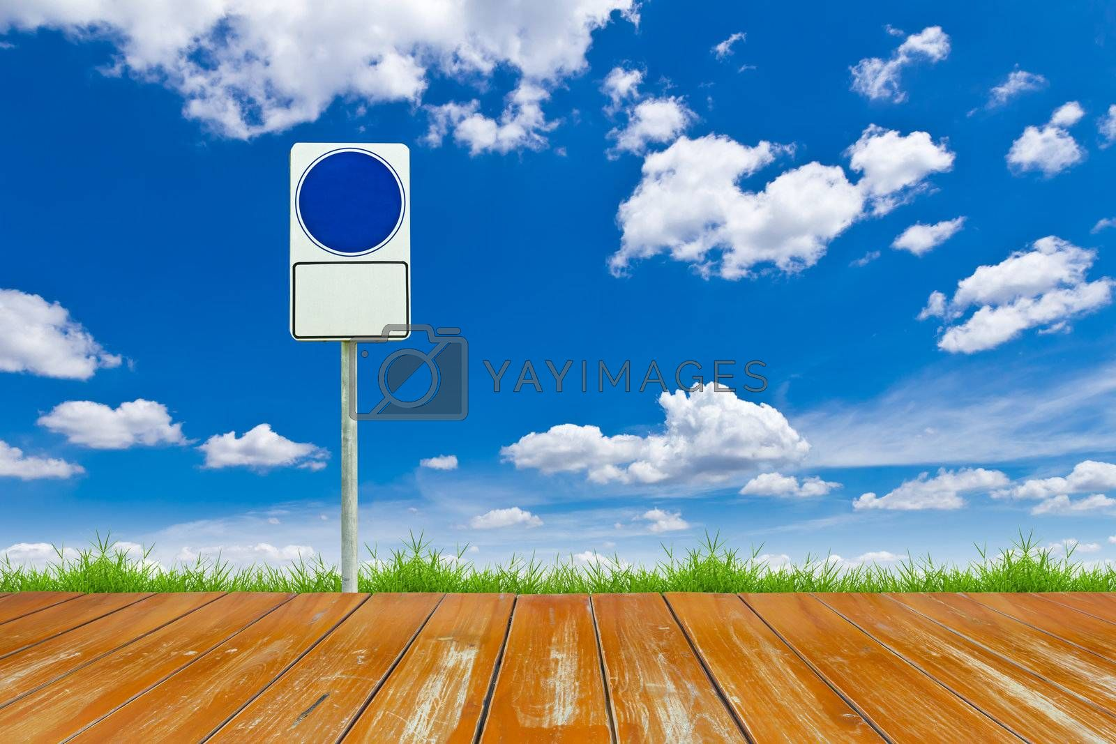 wood way and blue blank sign on blue sky