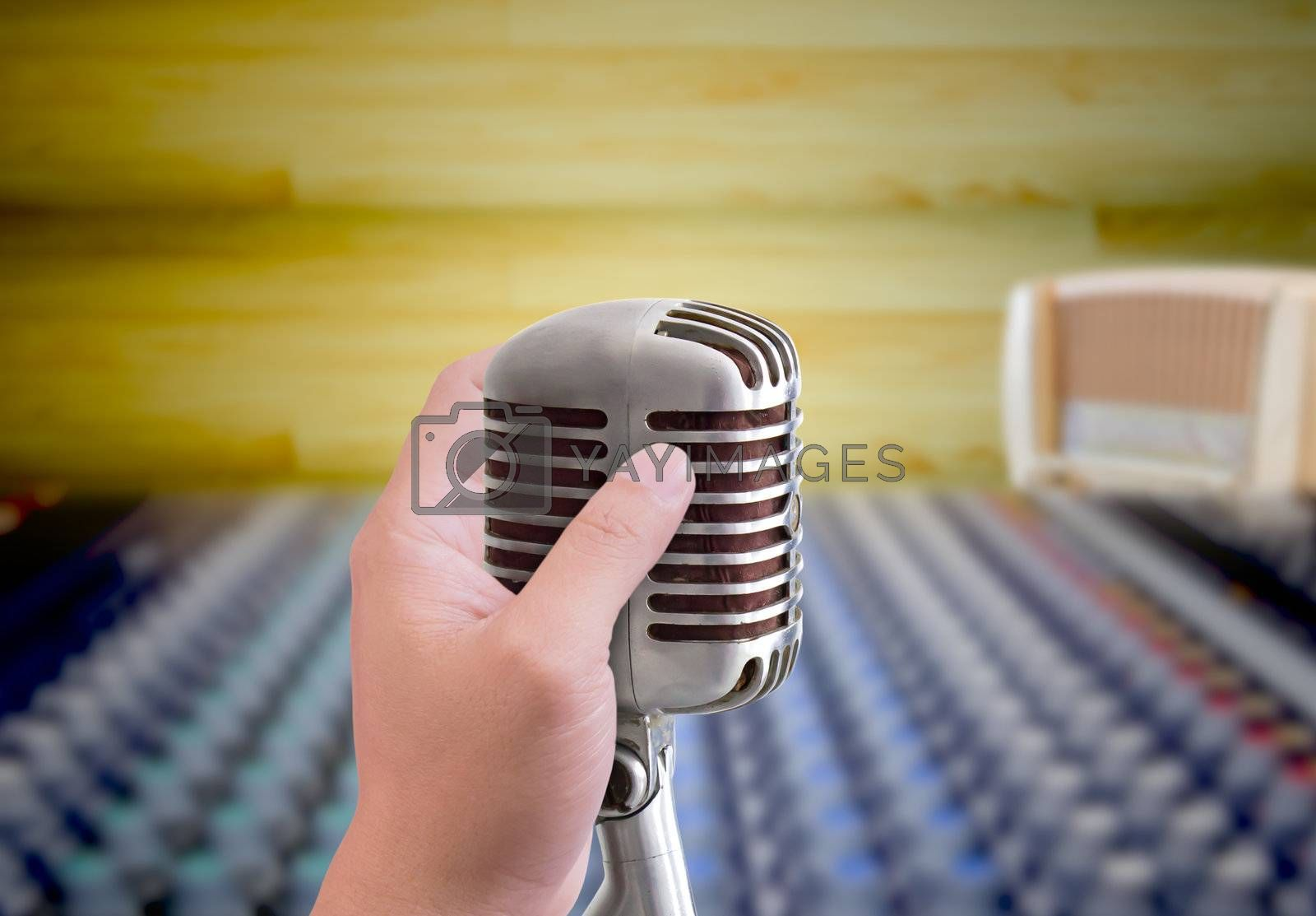 hand holding microphone in sound record room