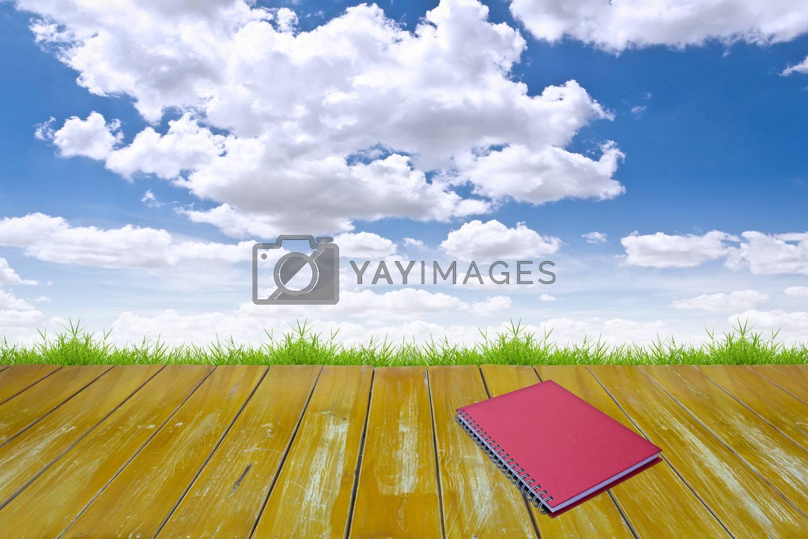 red notebook on wood floor