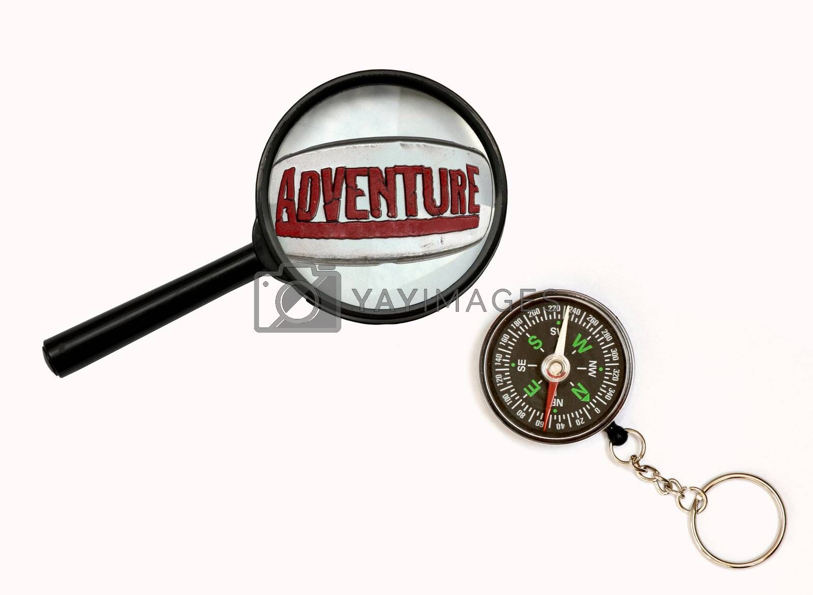 An image of magnifier and compass