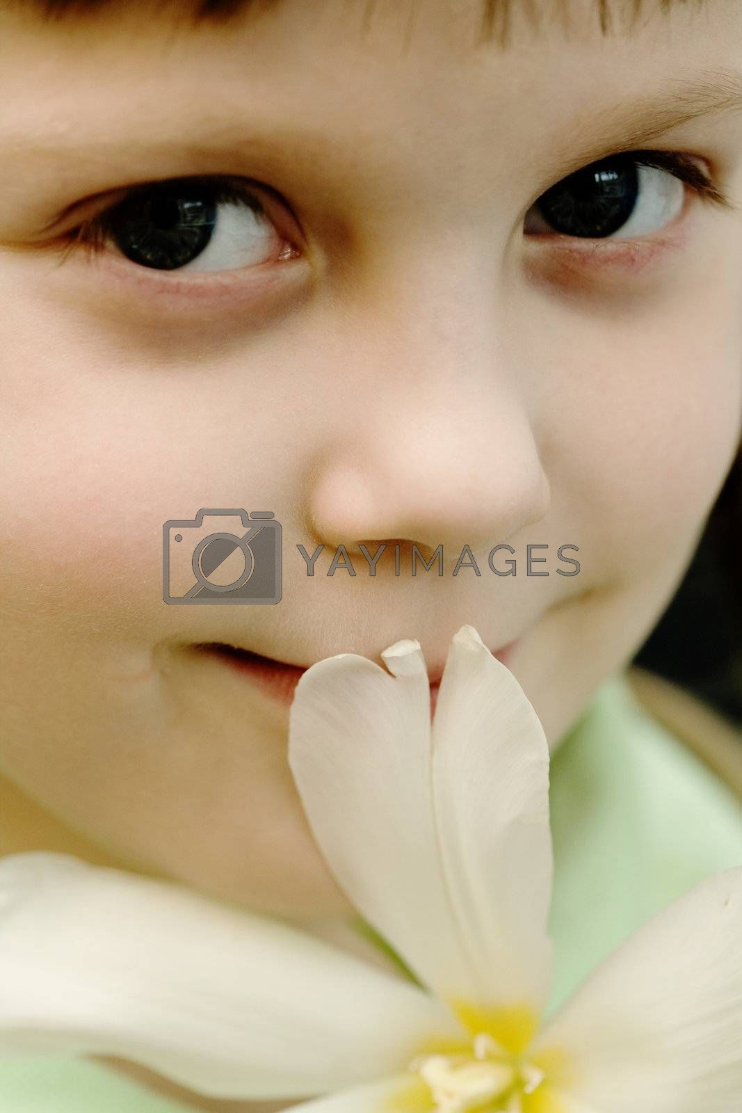 Stock photo: an image of a beautiful girl with a flower