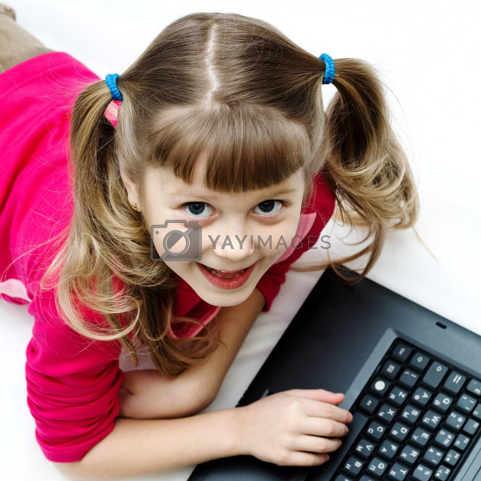 An image of a pretty girl with laptop on the floor
