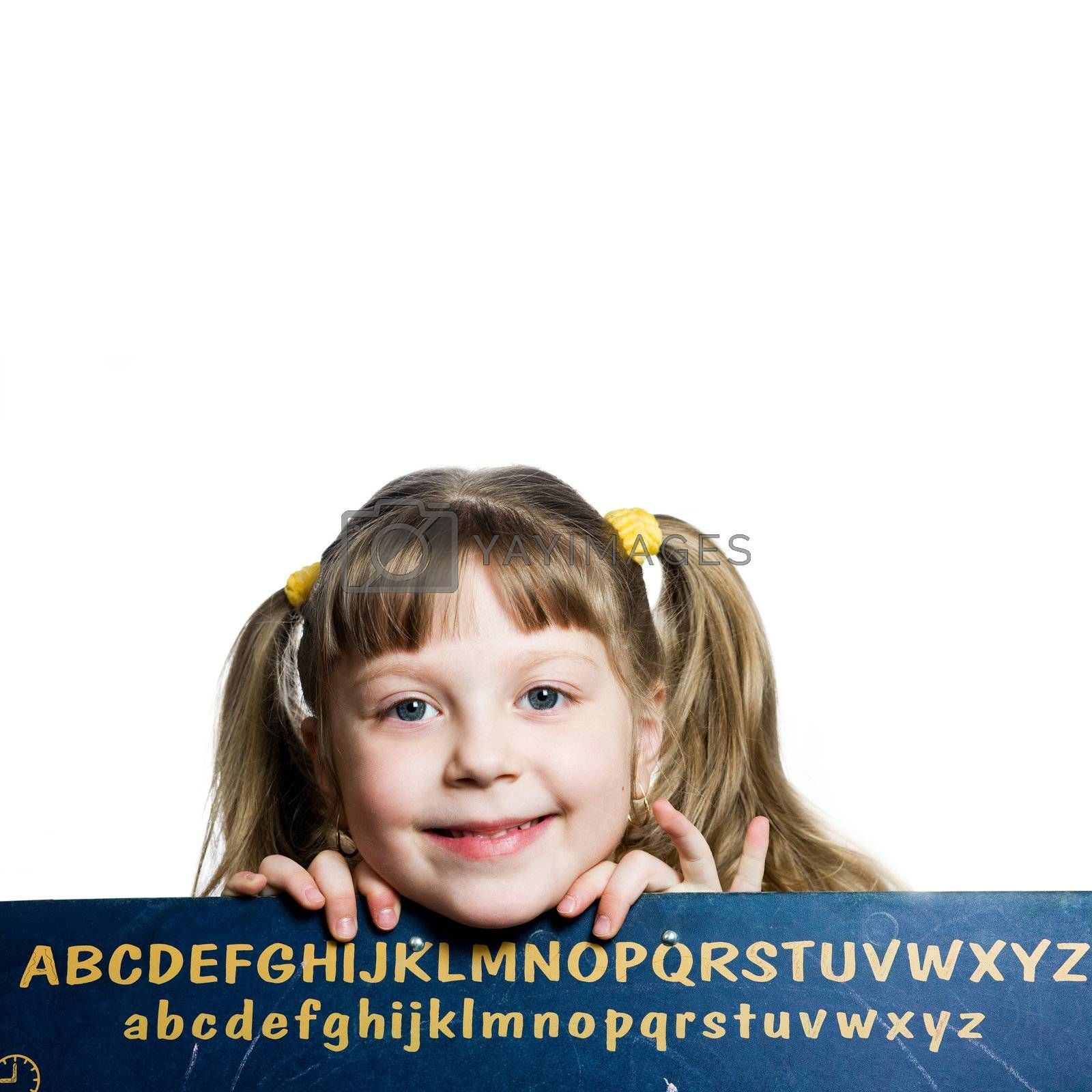 An image of a smiling girl and blackboard