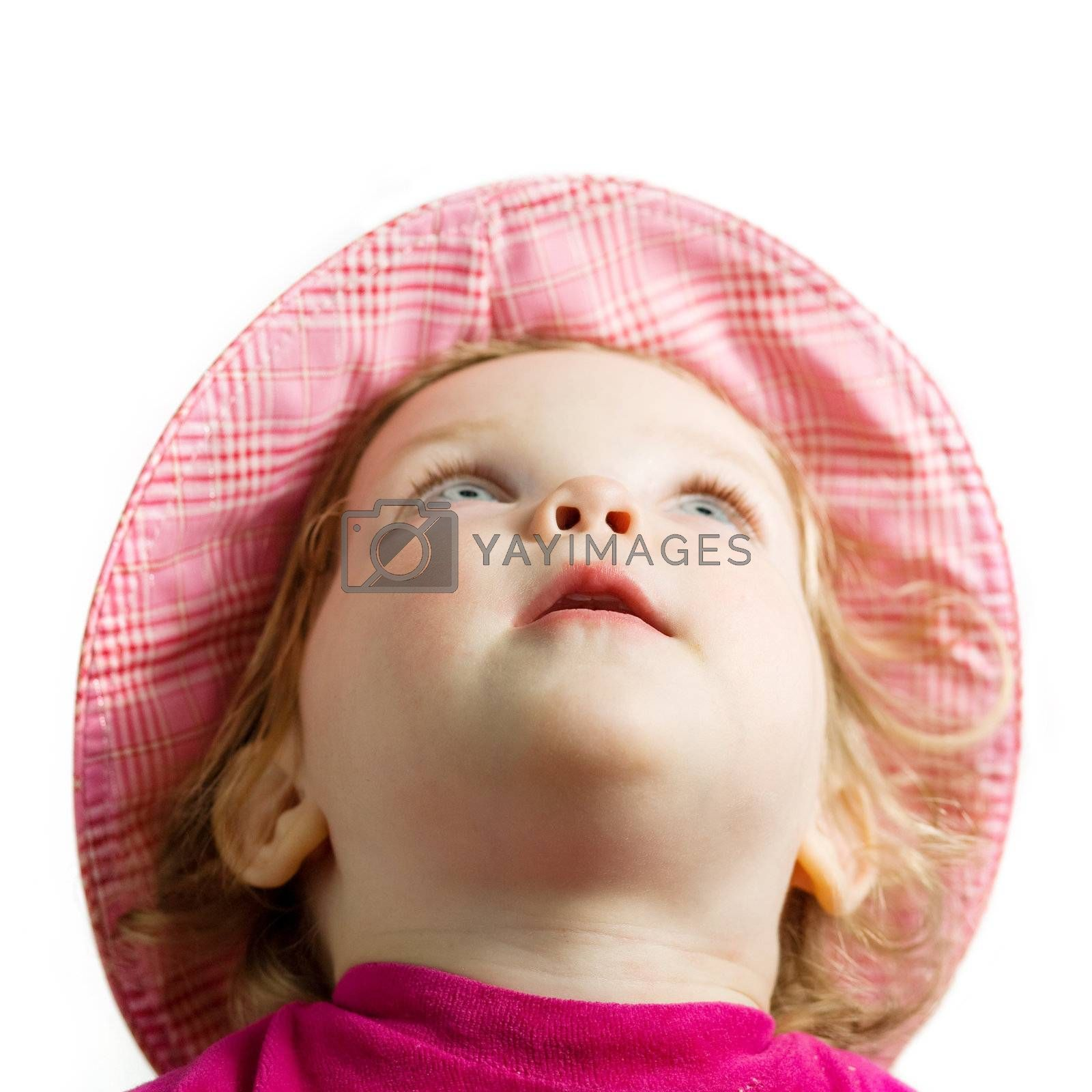 Stock photo: an image of a baby in a hat looking up