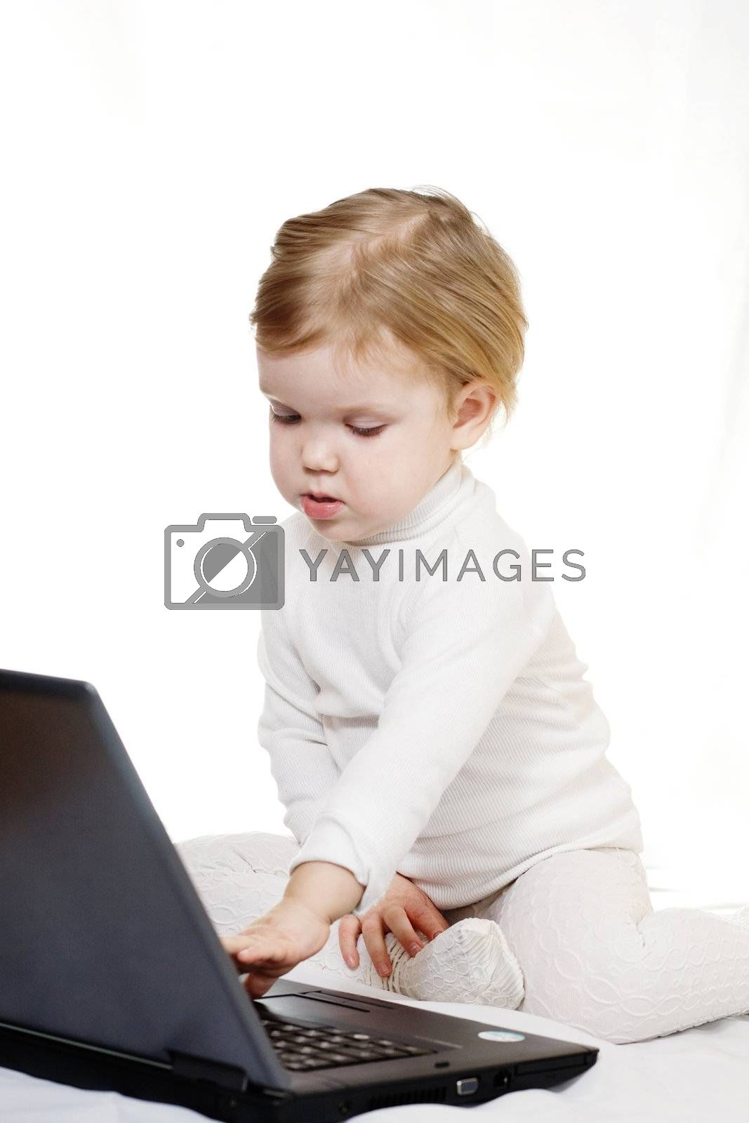 Stock photo: an image of a baby with black laptop