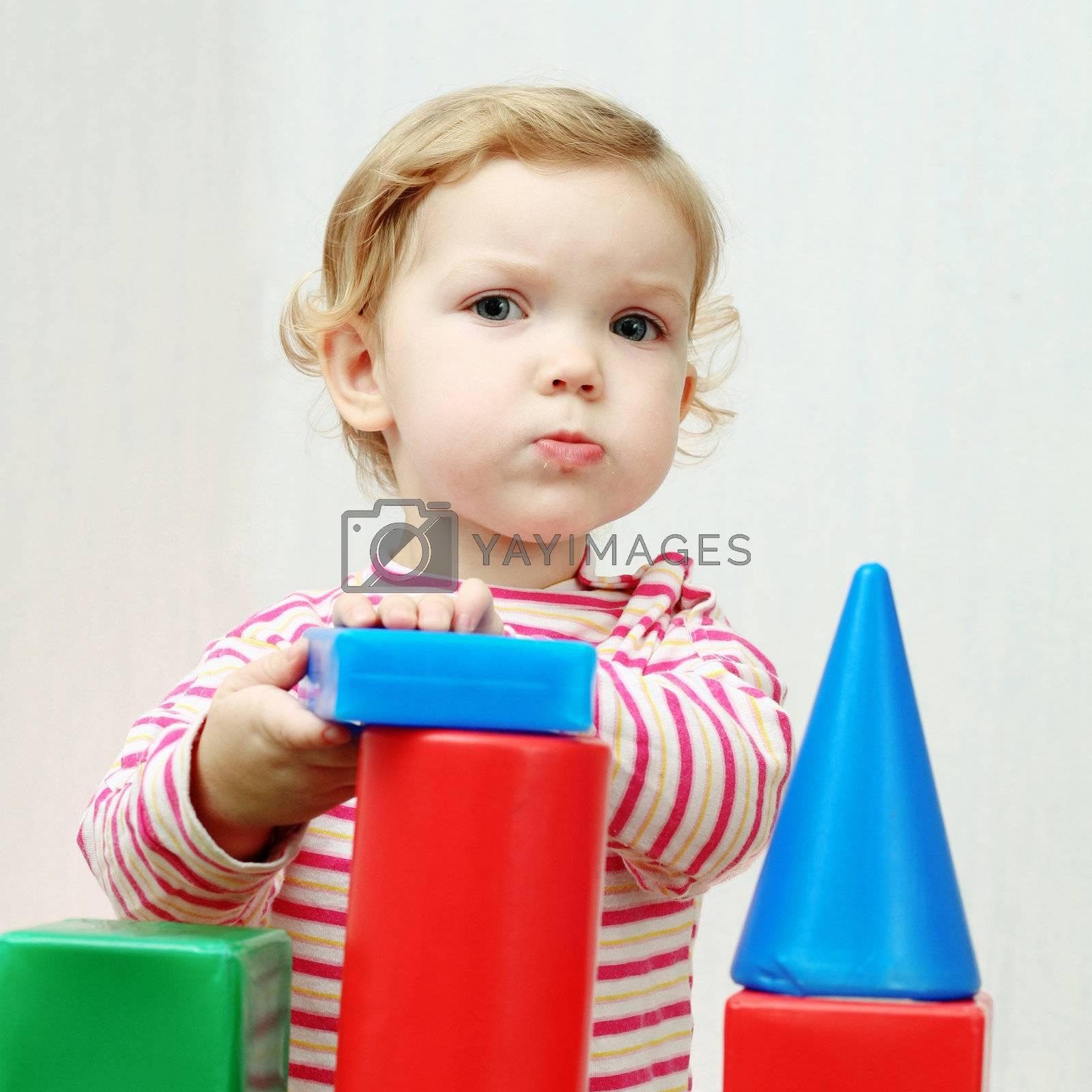 An image of a nice playing baby girl