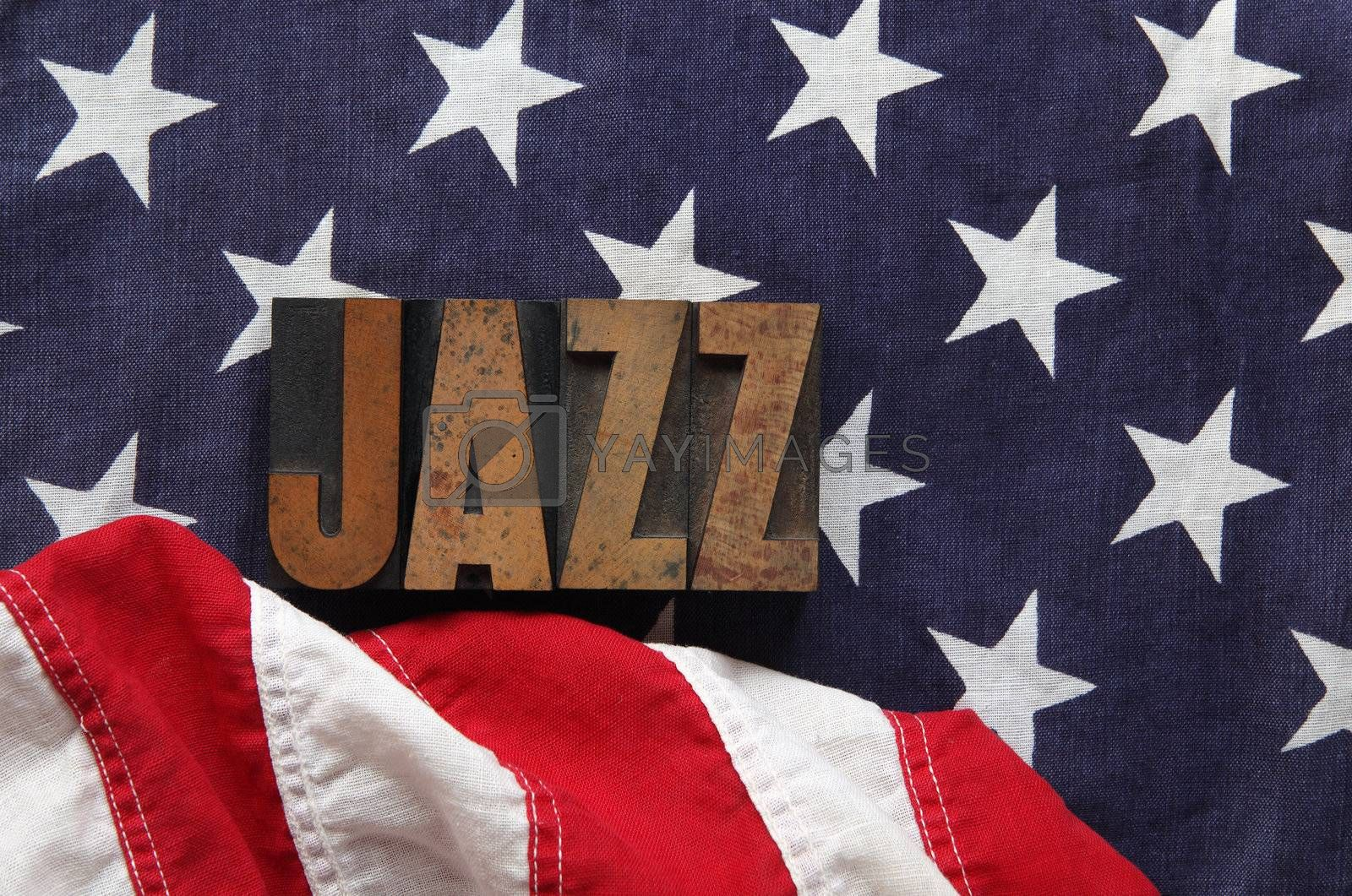an old flag with the word jazz in old, ink-stained wood type