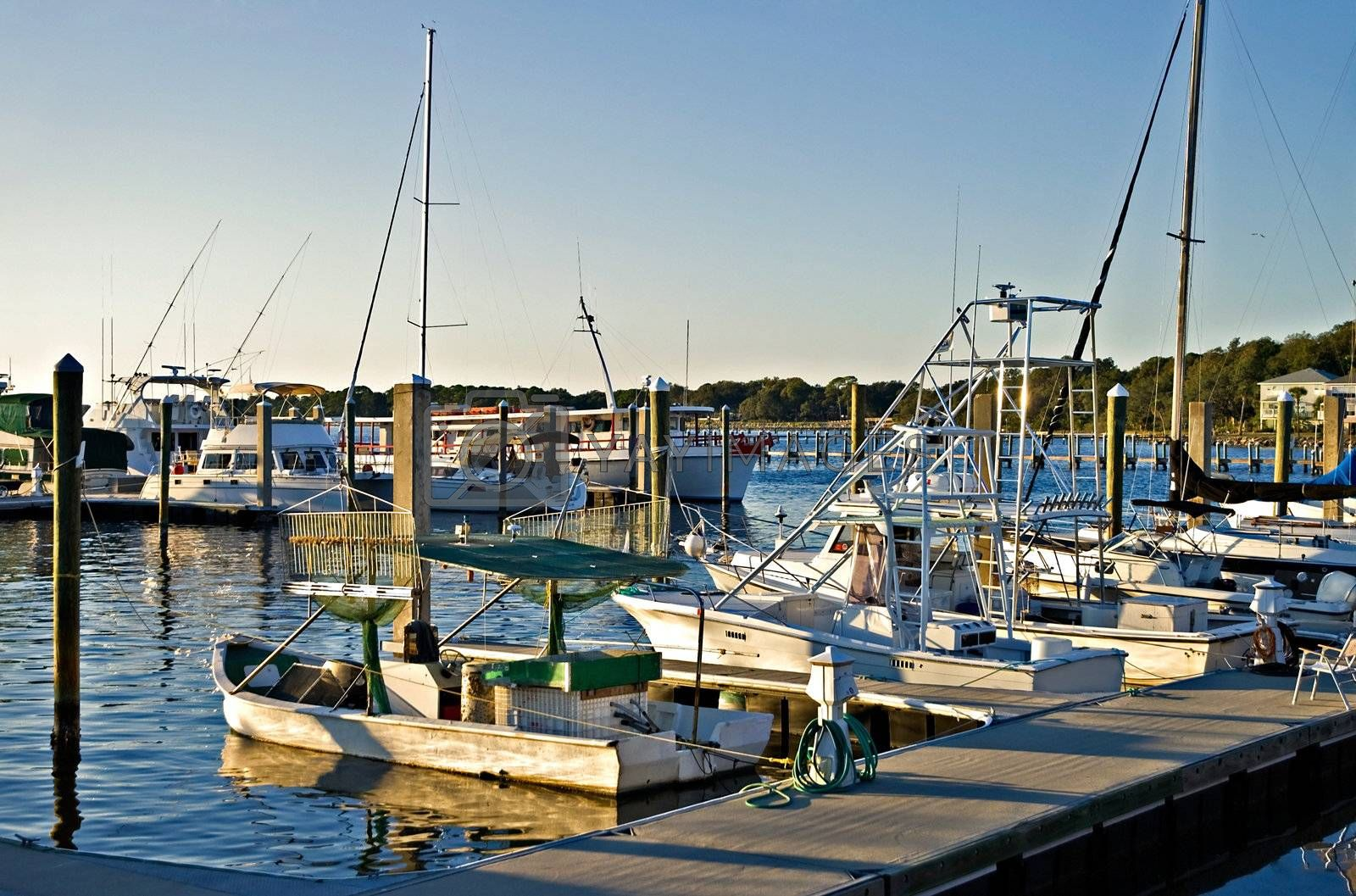 Many different types of boats docked at the end of the day.