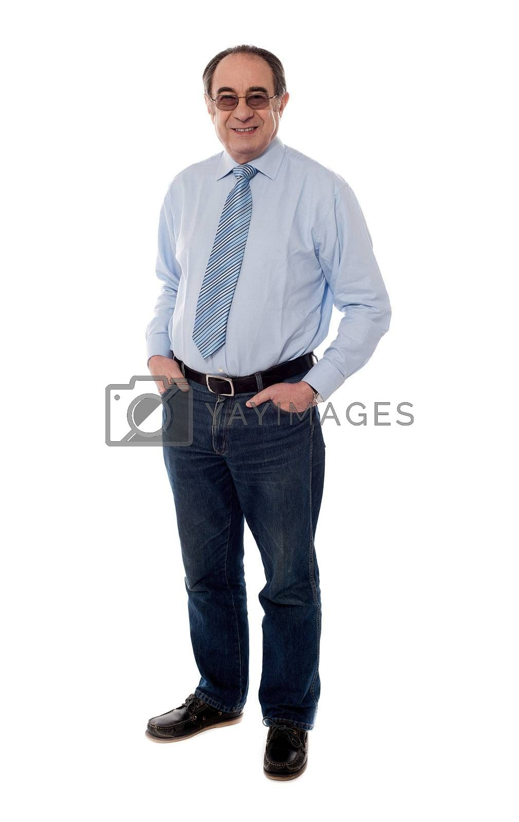 Relaxed old man posing with hands in pocket, casual style