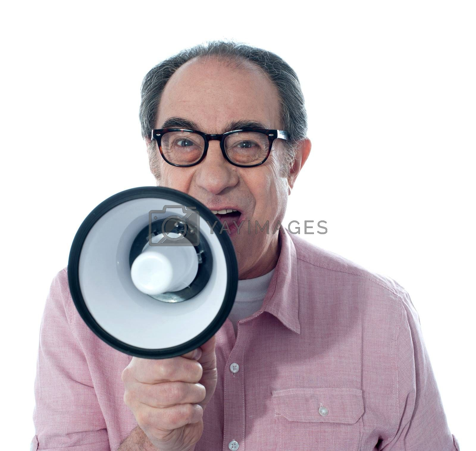 Excited old man making an announcement through megaphone, close to camera