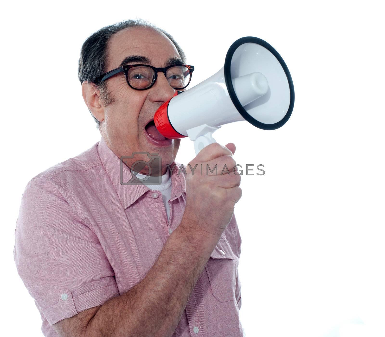 Senior male screaming loudly in a megaphone