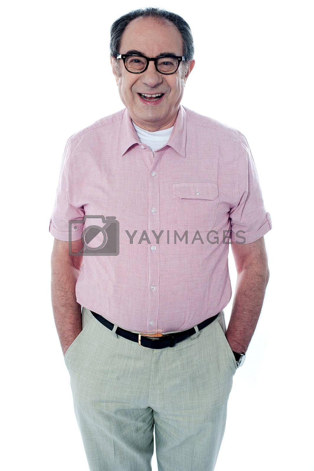 Smiling casual senior man with hands in pocket isolated on white