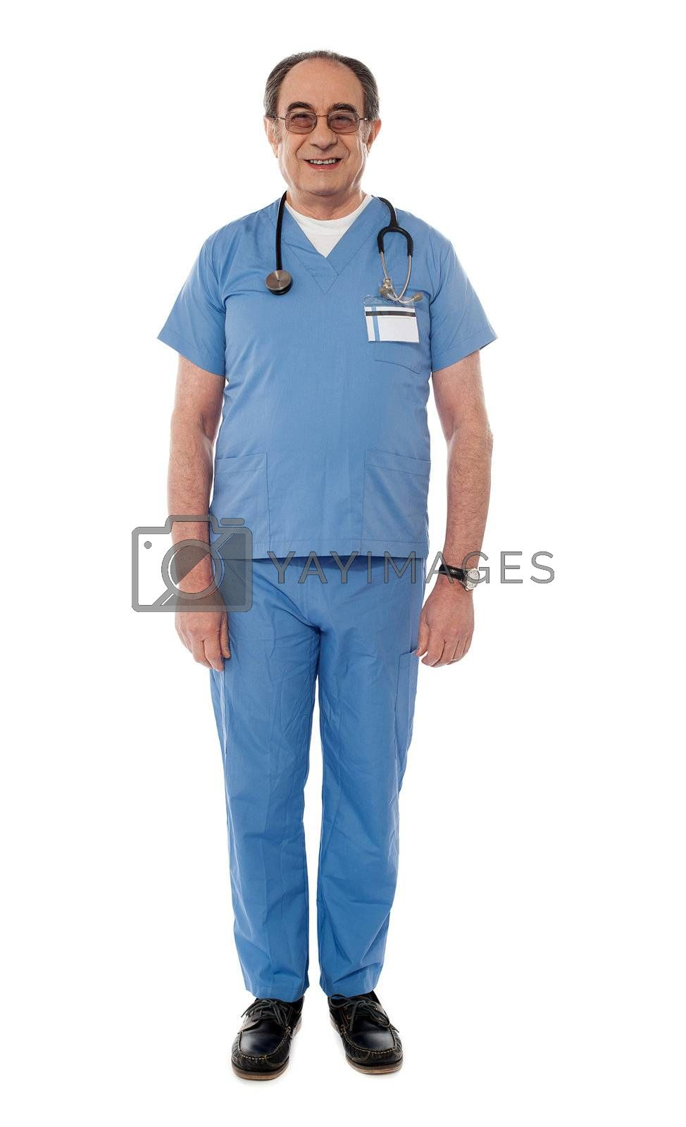 Full length view of senior doctor posing in front of camera
