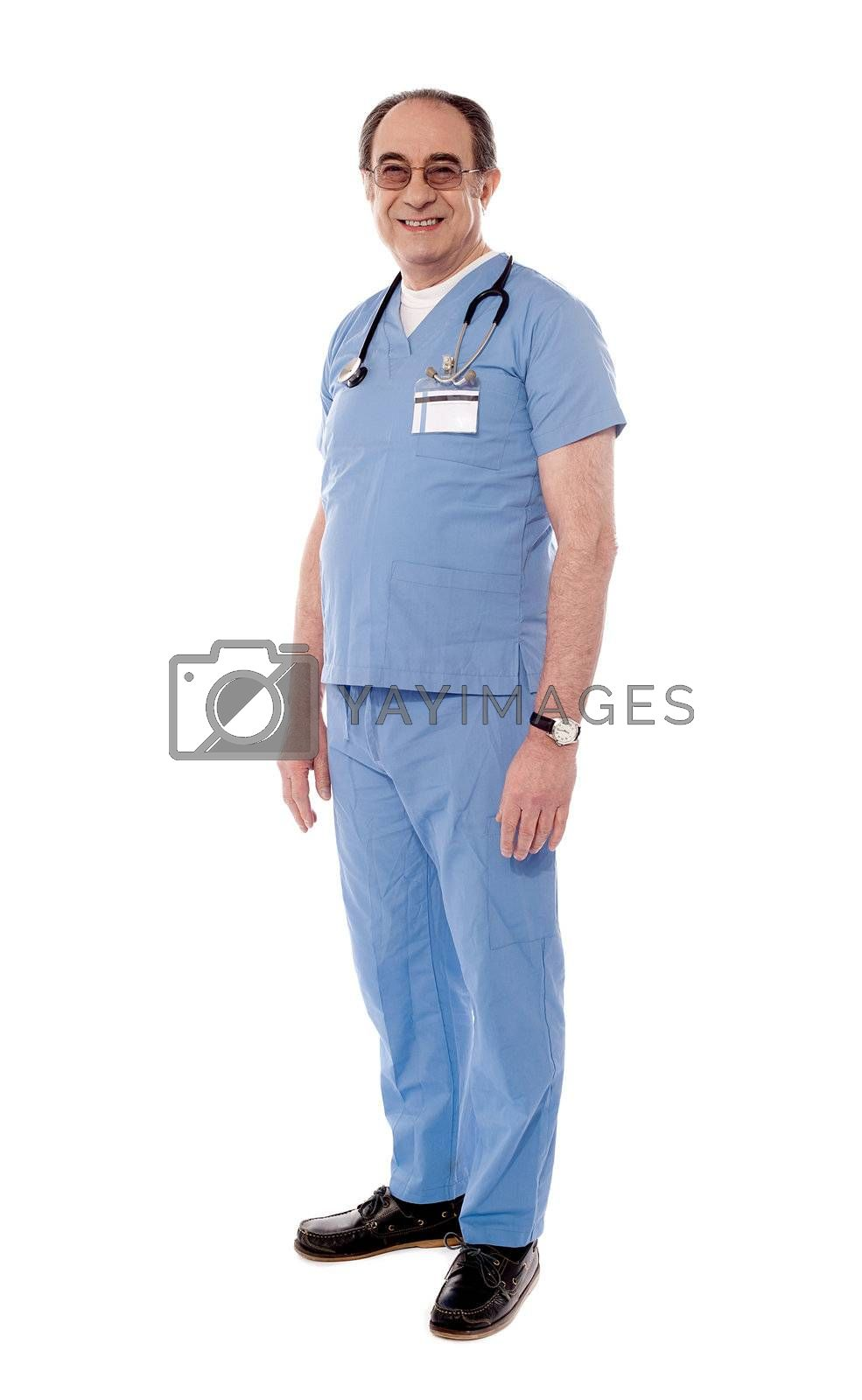 Aged doctor standing in style isolated on white background