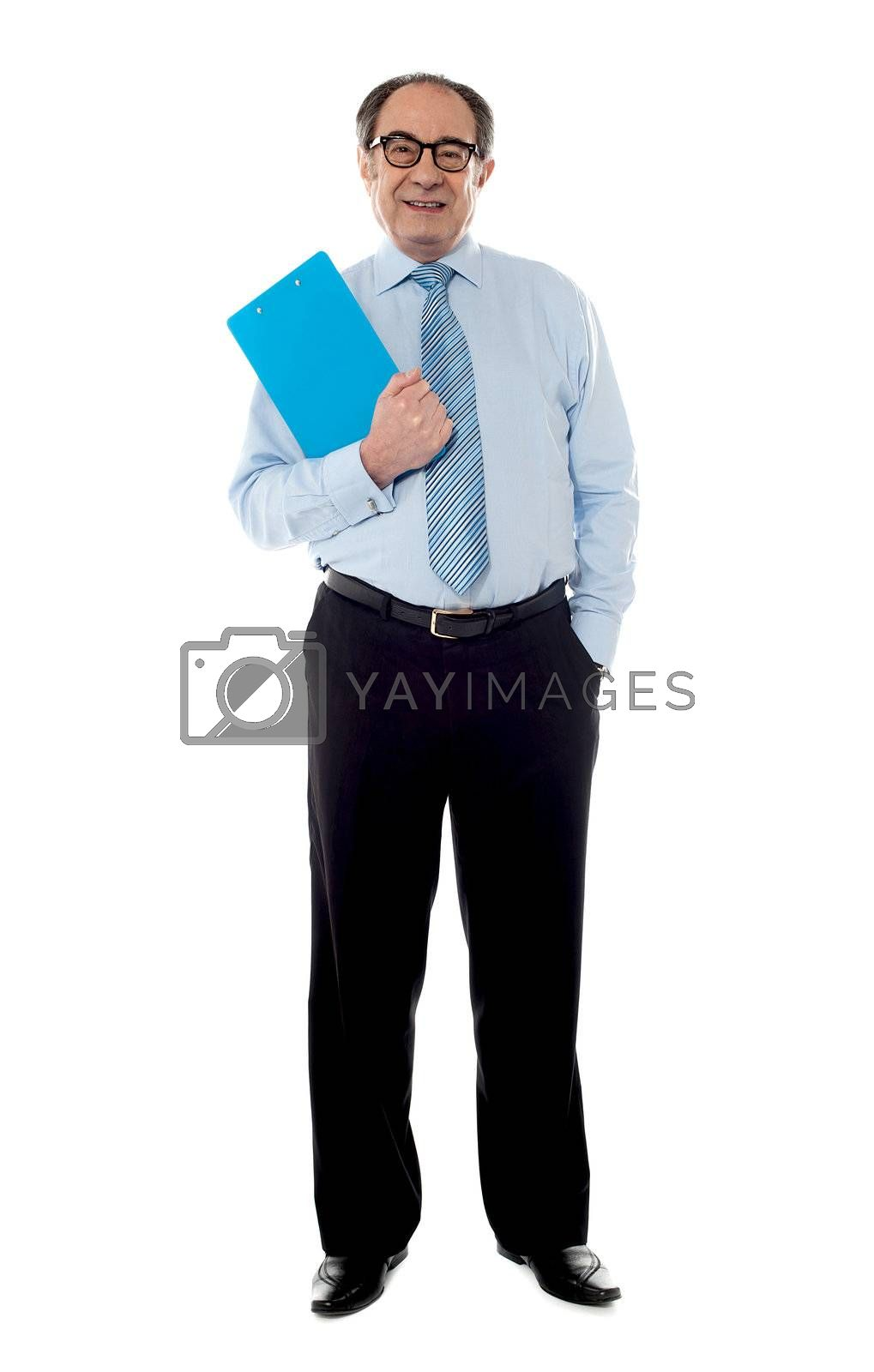 Corporate businessman holding document, posing in style