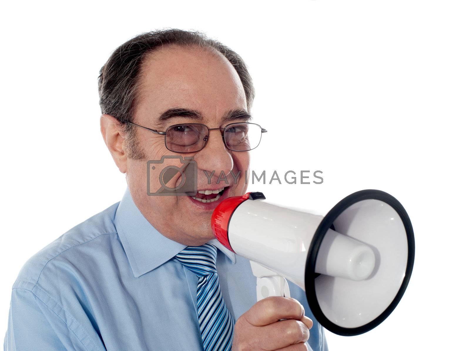 Elderly businessman making an announcement through megaphone