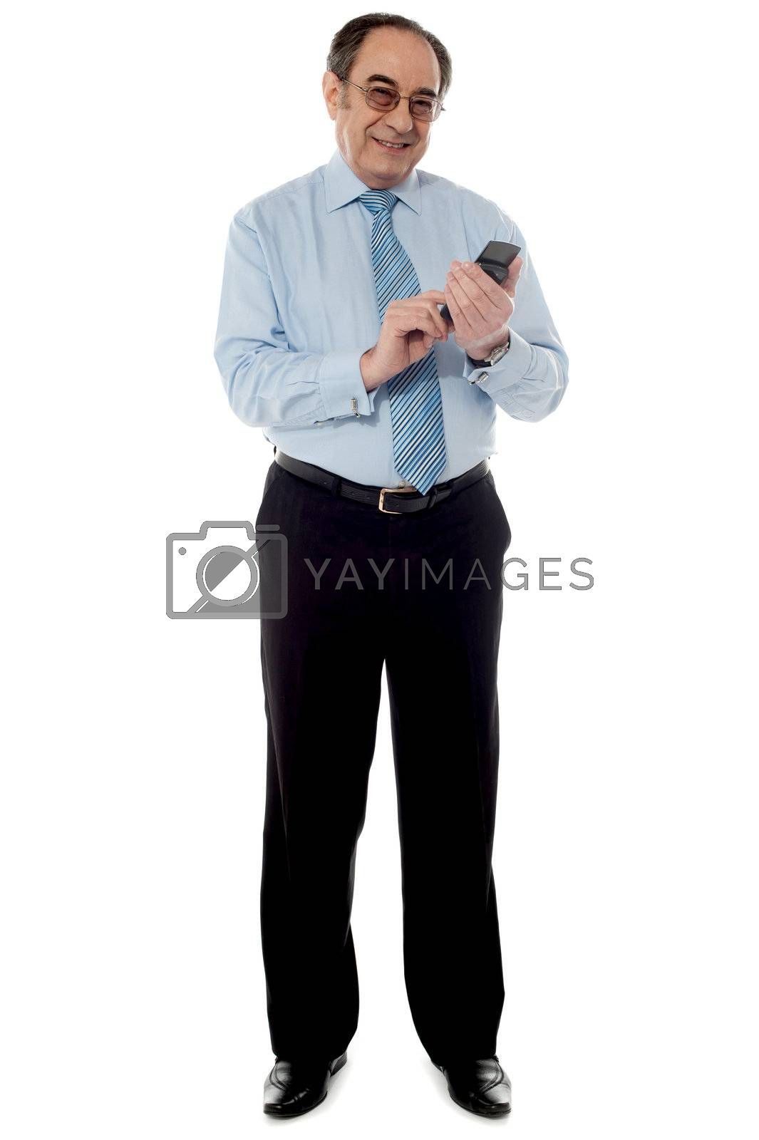 Corporate senior man using cellphone isolated over white