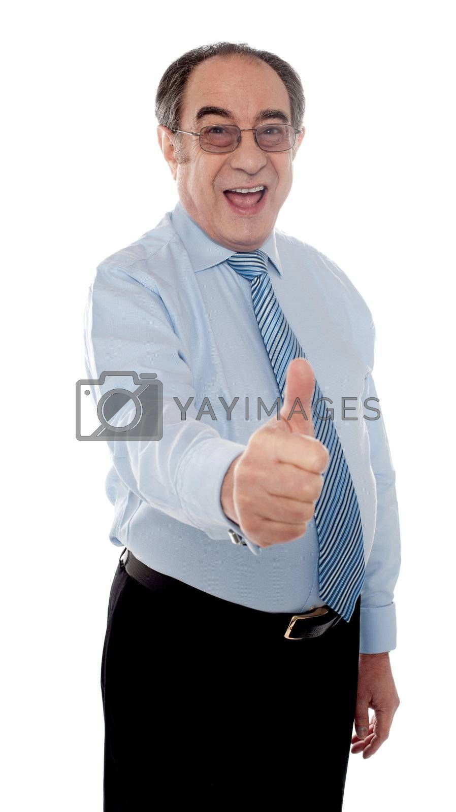 Handsome senior manager gesturing thumbs-up at you against white background