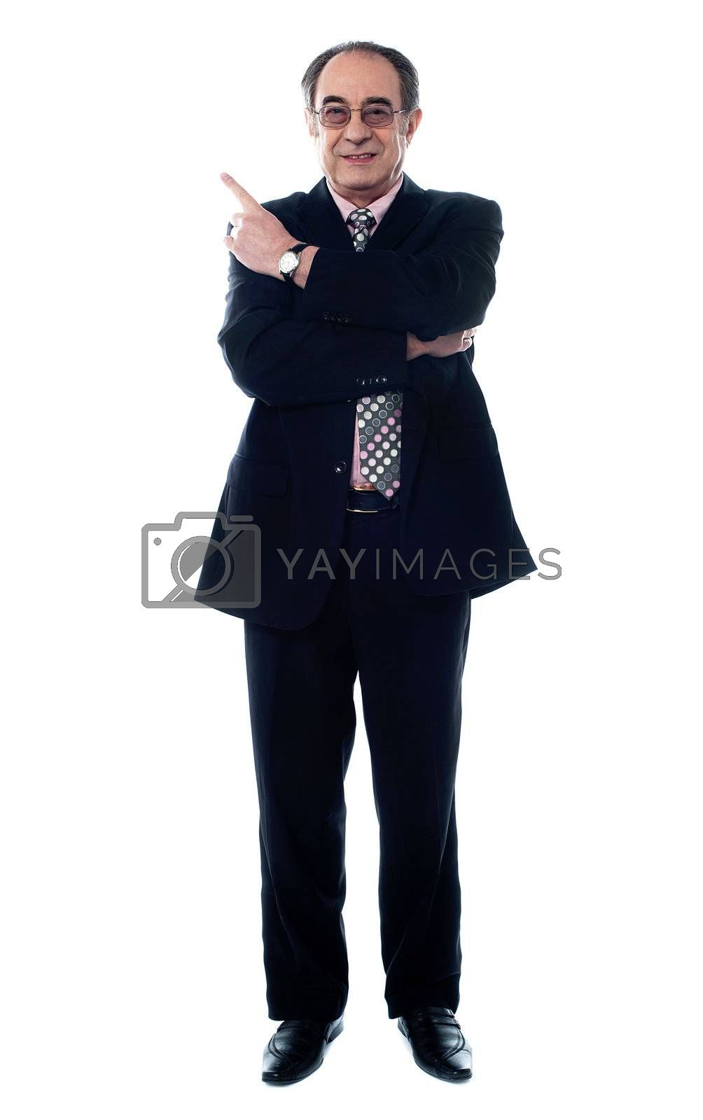 Smiling old businessperson pointing up isolated on white background