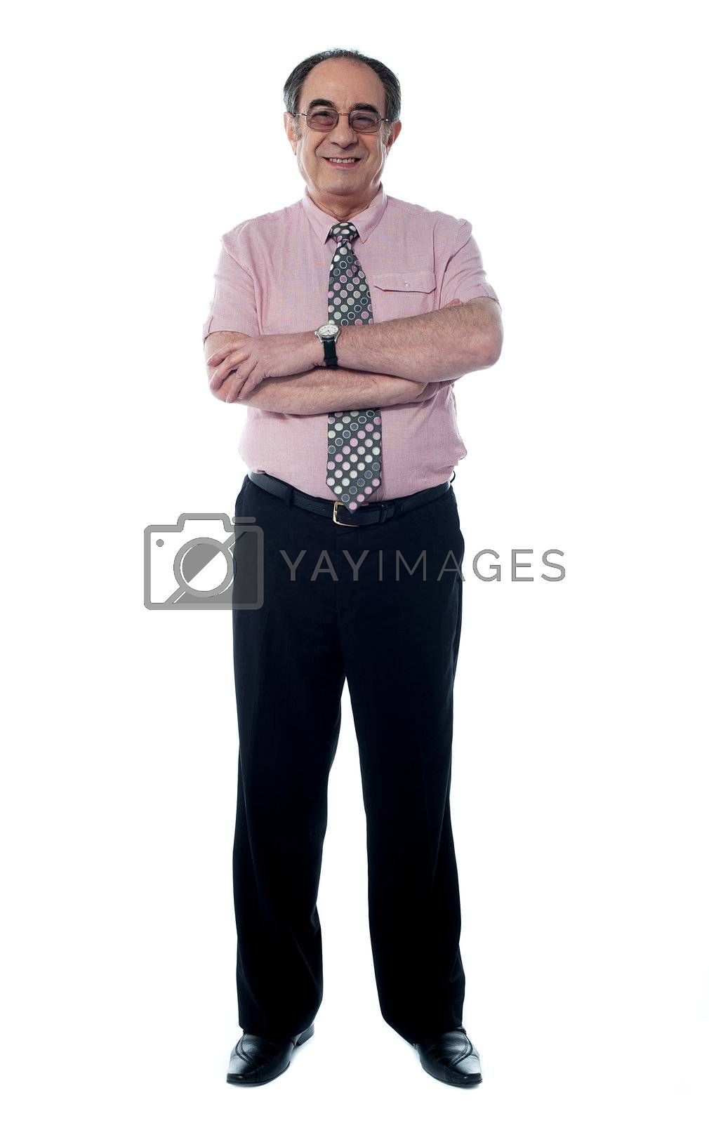 Senior business executive in pink shirt and tie posing with crossed arms isolated on white