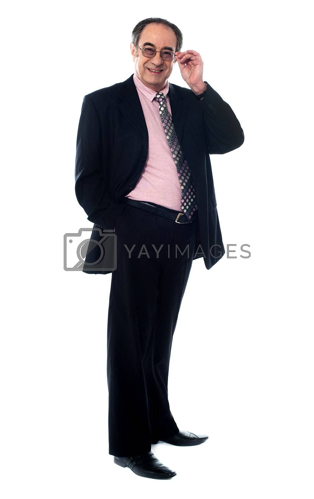 Old businessperson looking at you within his eye-wear isolated on white