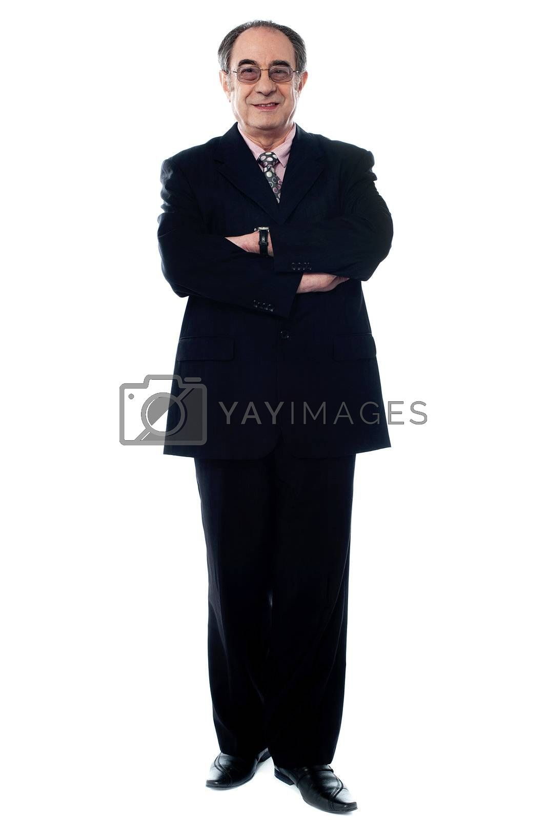 Businessman in a black suit posing in front of camera
