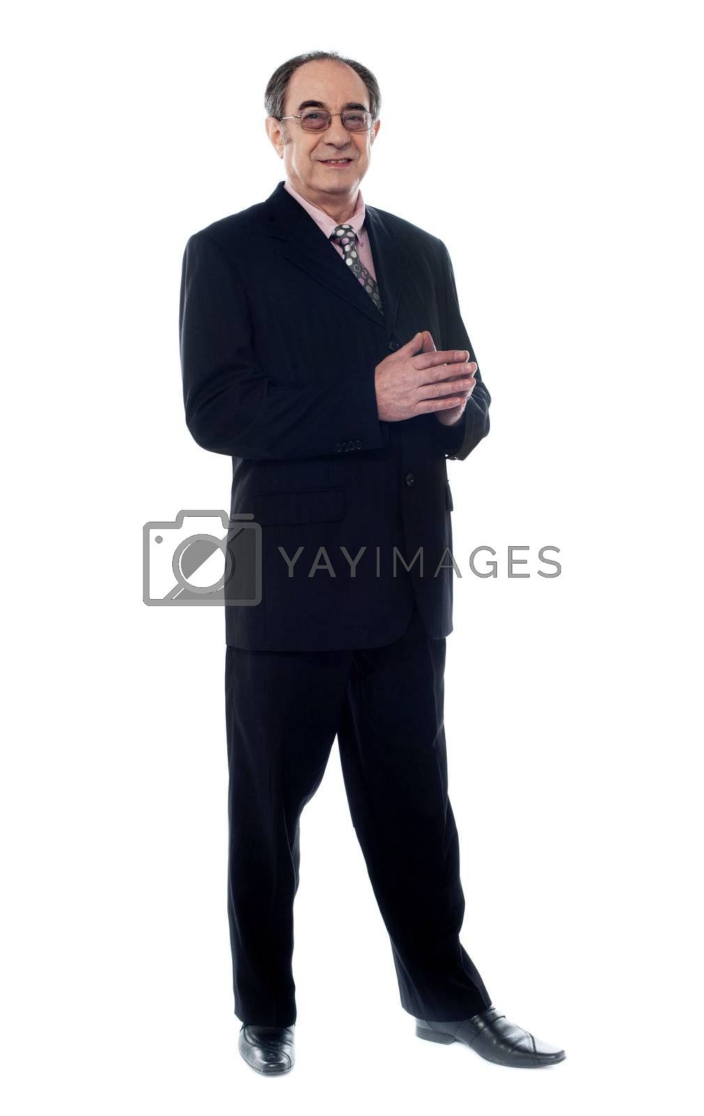 Smiling corporate person suited in black posing in front of camera