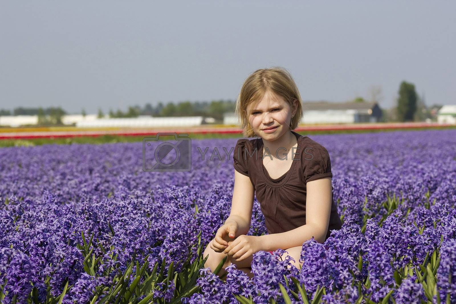little girl in the hyacinth flowers