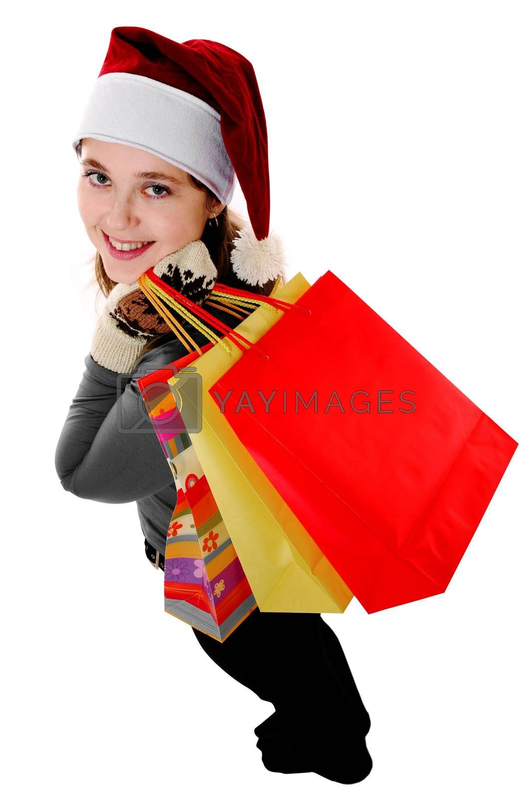 An image of a girl in red christmas cap with bags