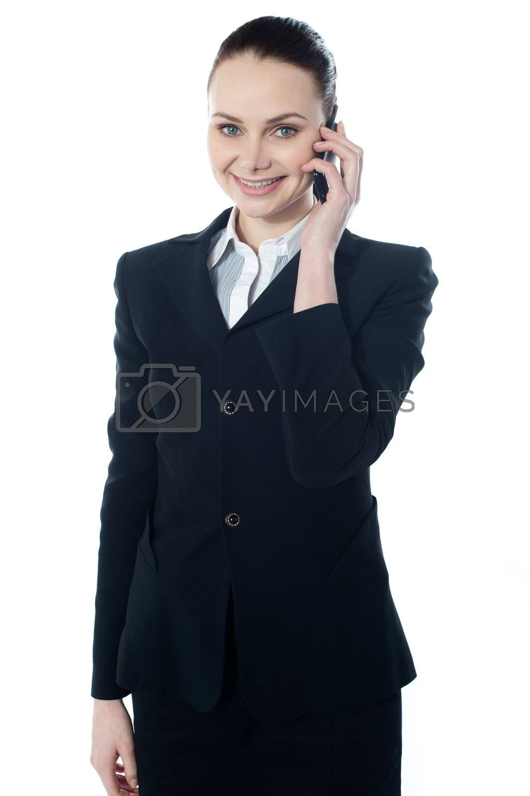 Mature businesswoman talking on mobile phone looking at you