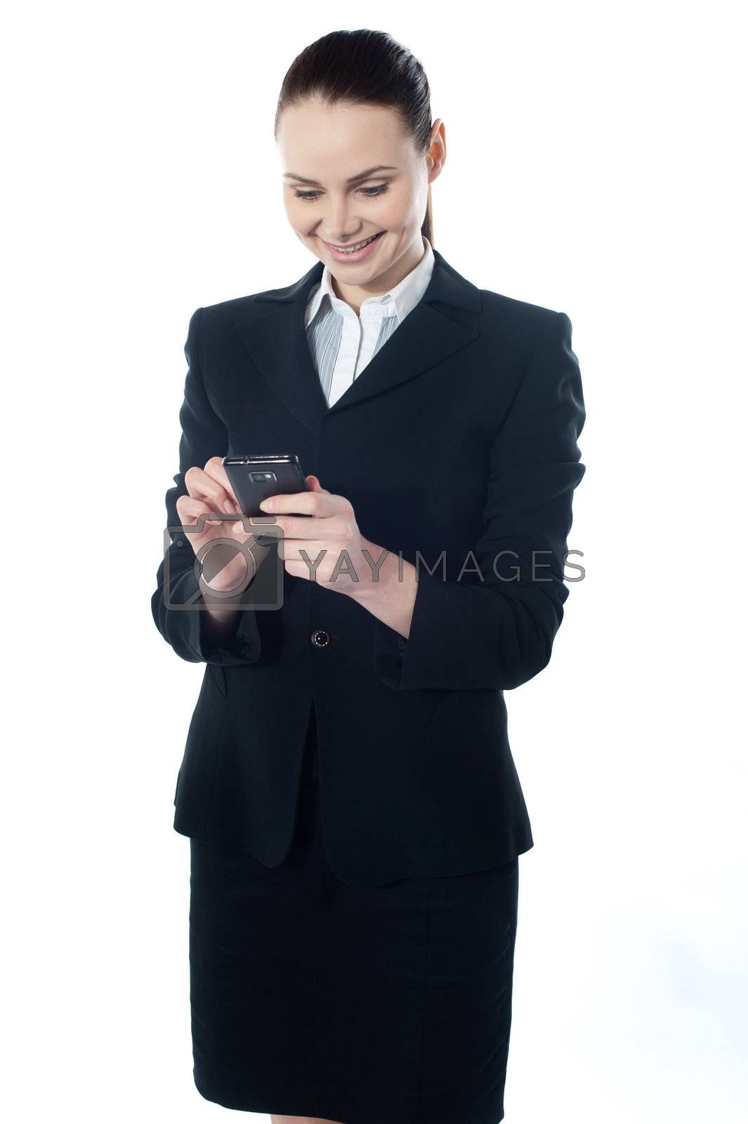 Confident businessperson messaging and smiling