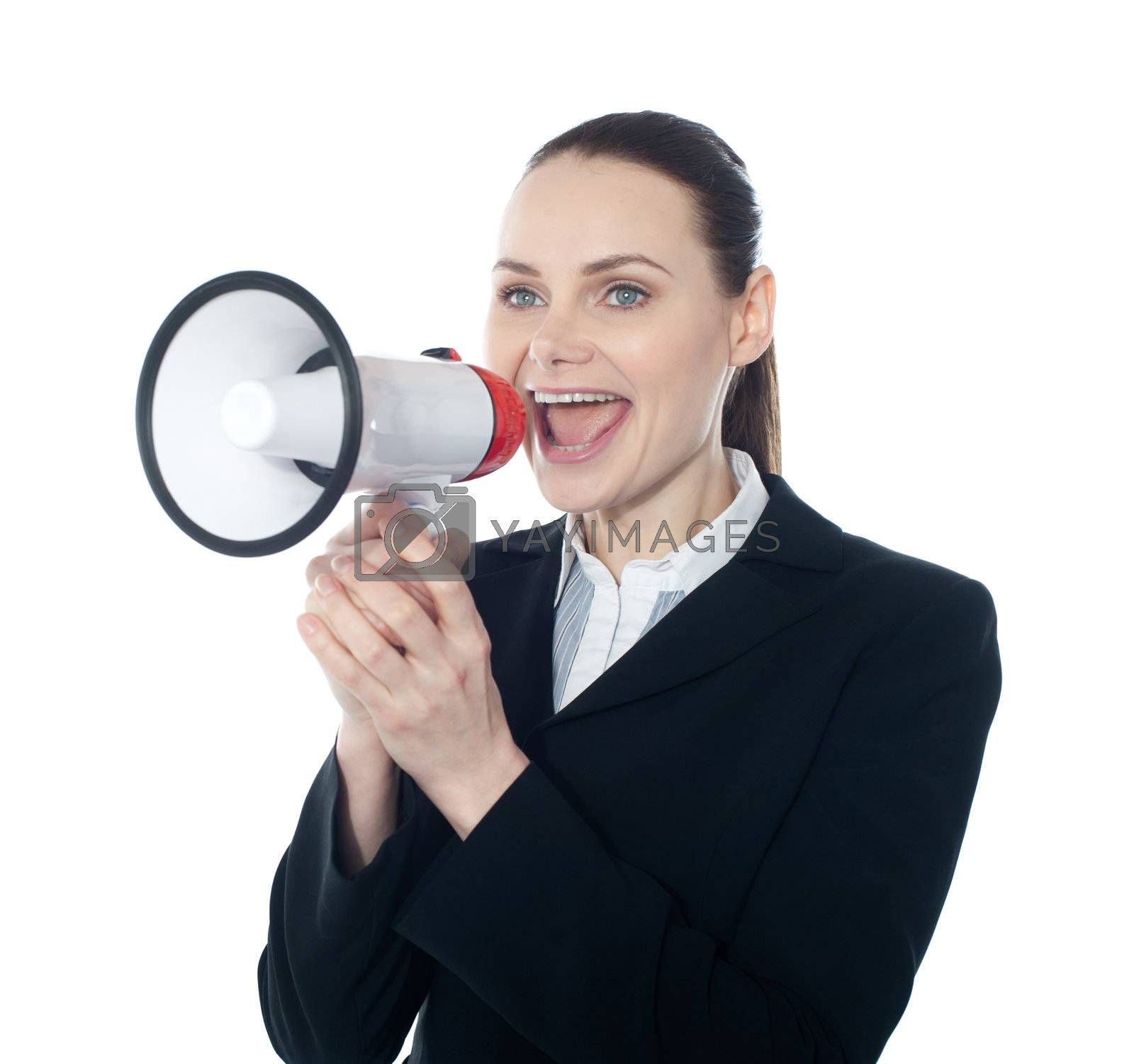 Pretty lady giving instructions with megaphone against white background