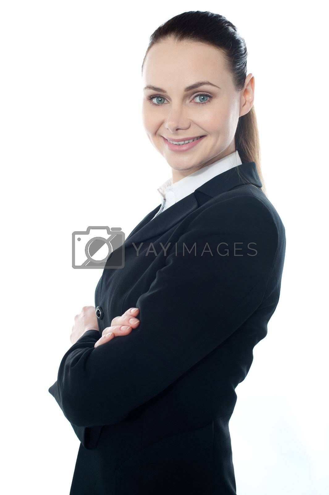 Closeup shot of successful businesswoman posing with crossed arms