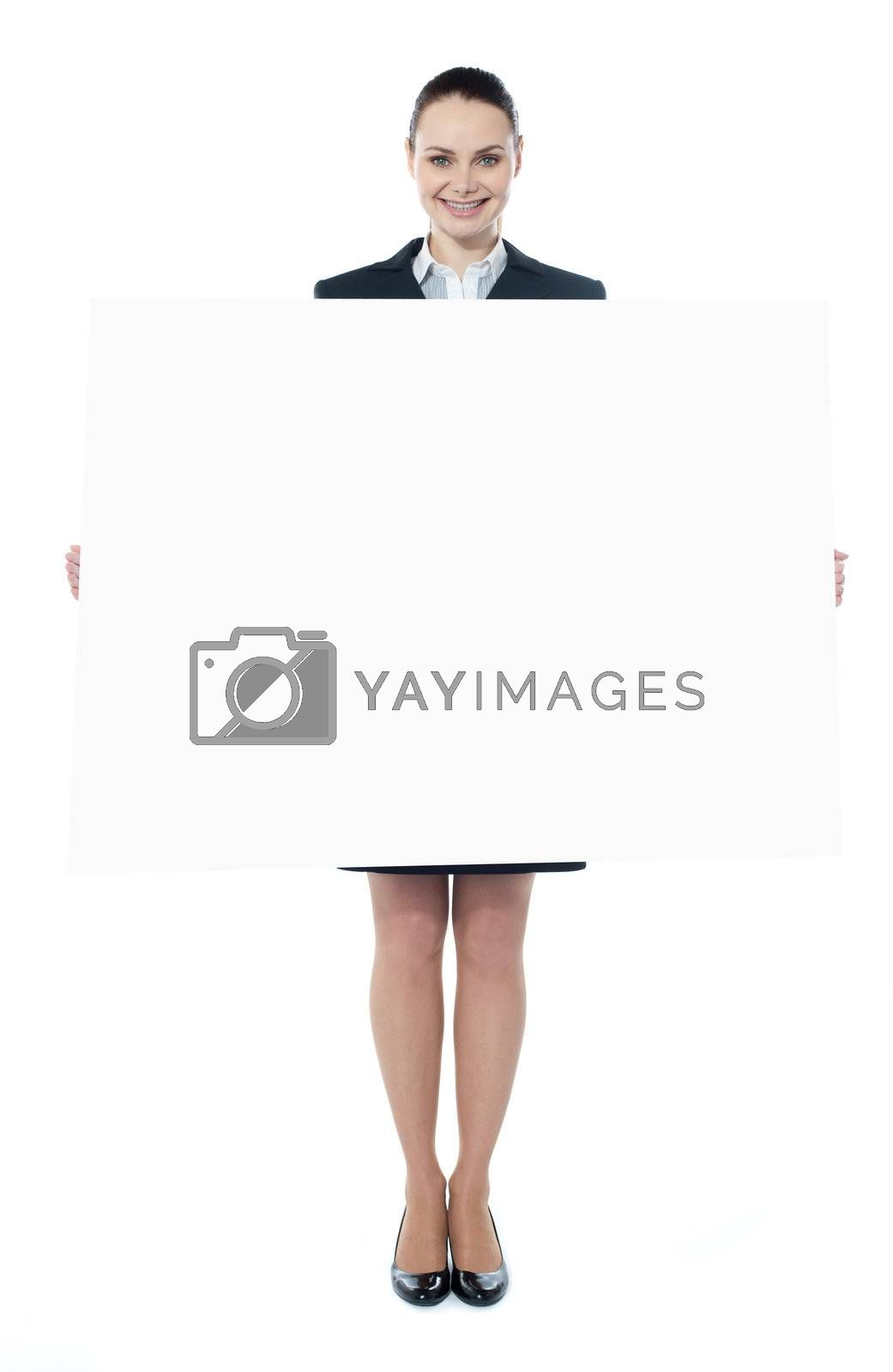 Confident young executive with an advertising board, smiling at camera