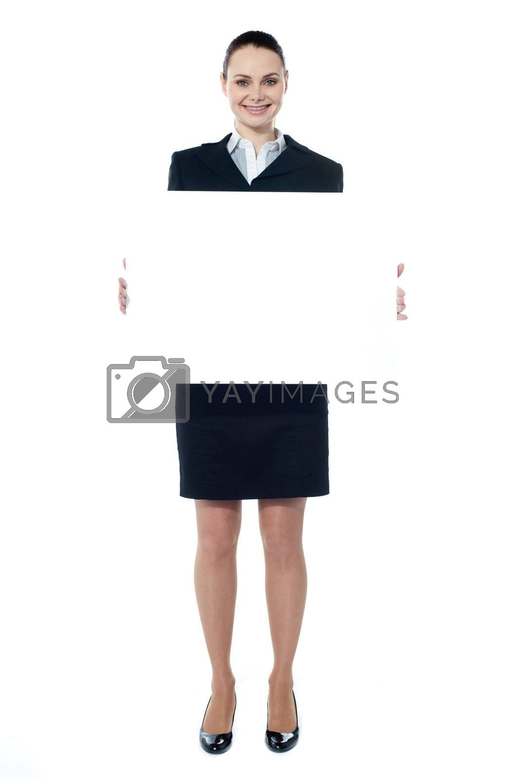 Caucasian businesswoman holding a blank billboard isolated on white background