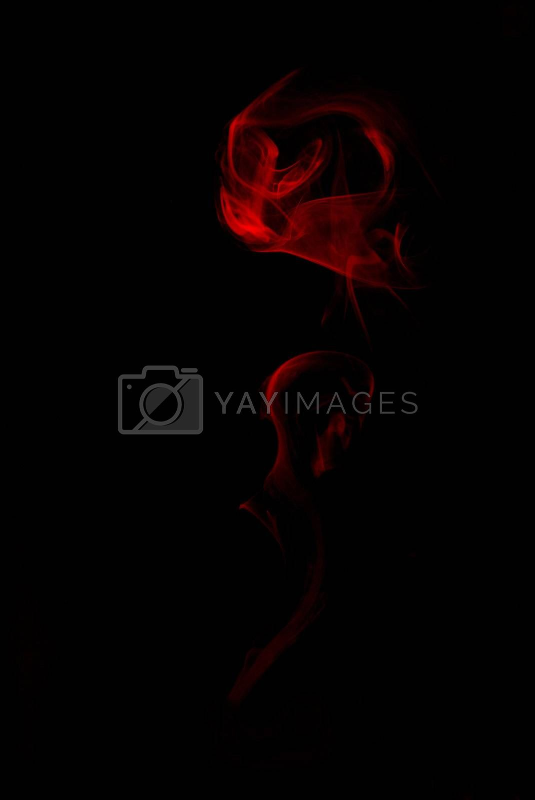 red smoke of flower on black background