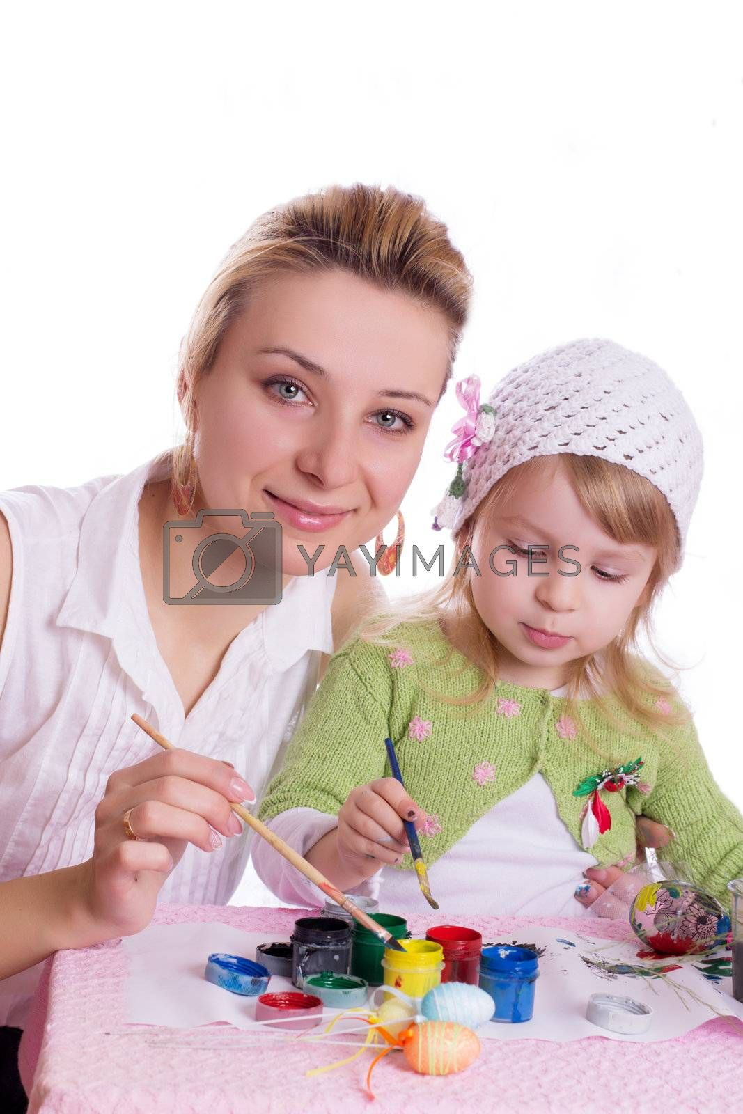 Mother and little daughter painting easter eggs isolated on white
