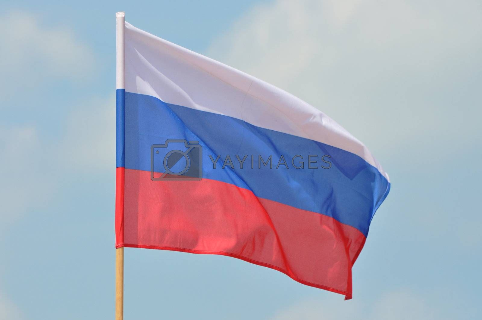 Flag of Russian Federation against blue sky