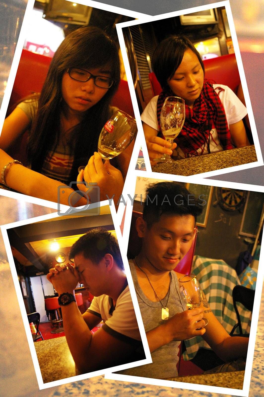 Asian people drinking wine in bar