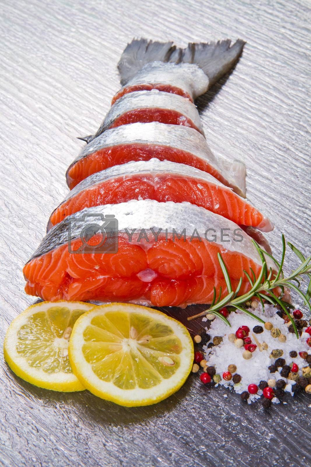 slice of fresh salmon with lemon , salt and pepper