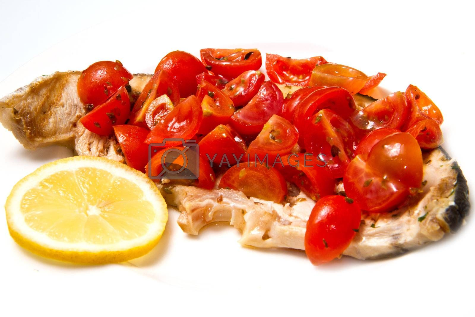 swordfish with tomatoes and lemon on white