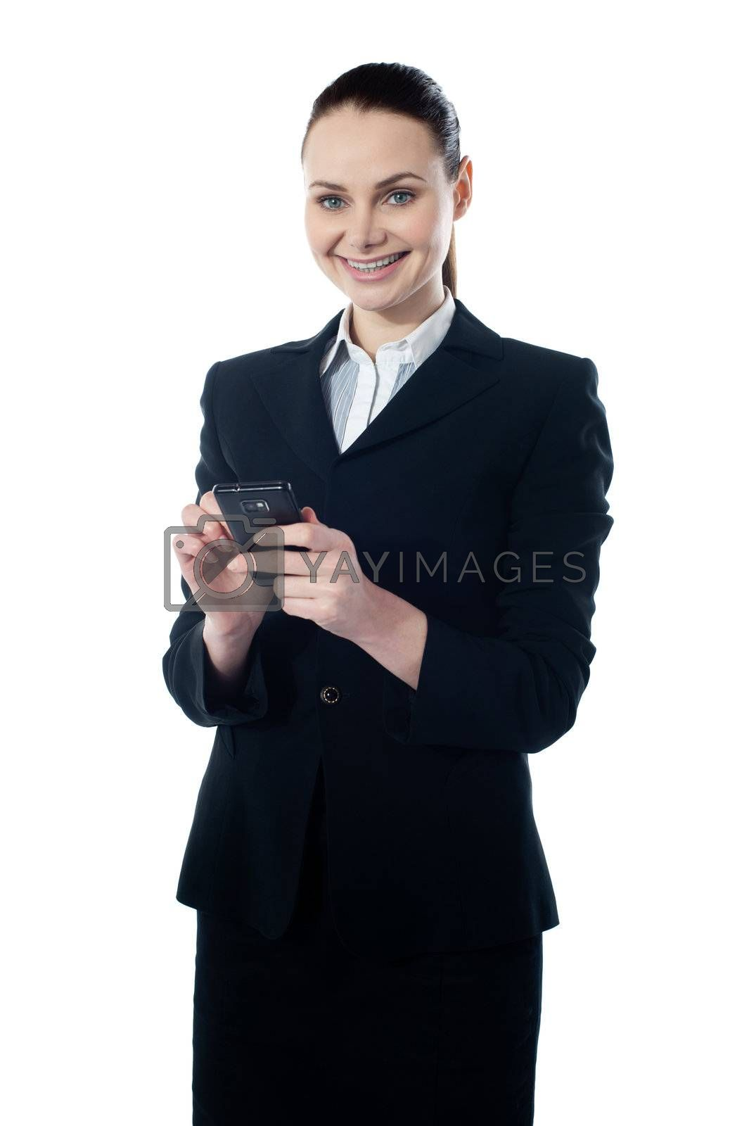 Corporate lady using mobile phone, sending message