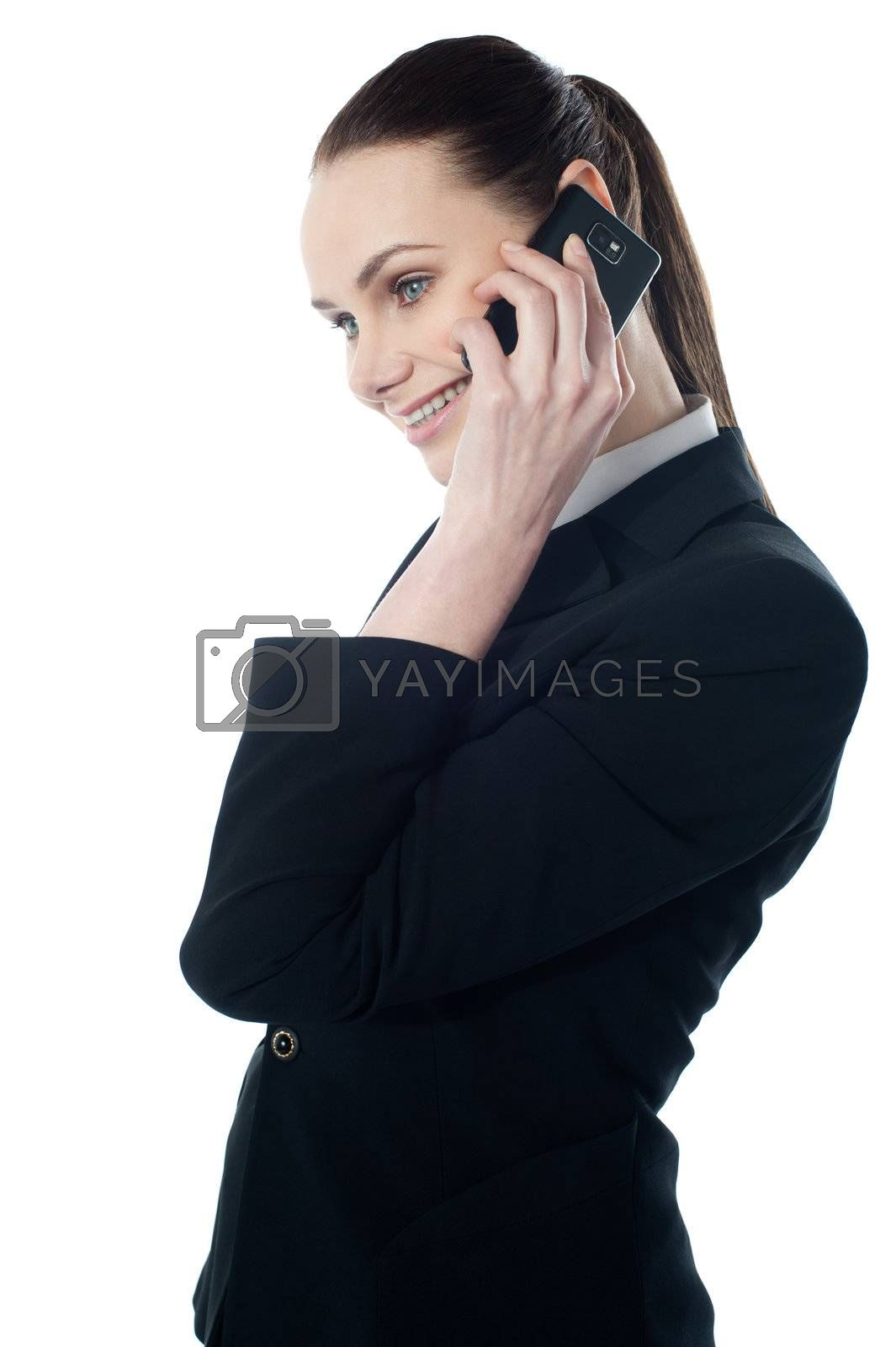 Pretty businesswoman communicating isolated over white
