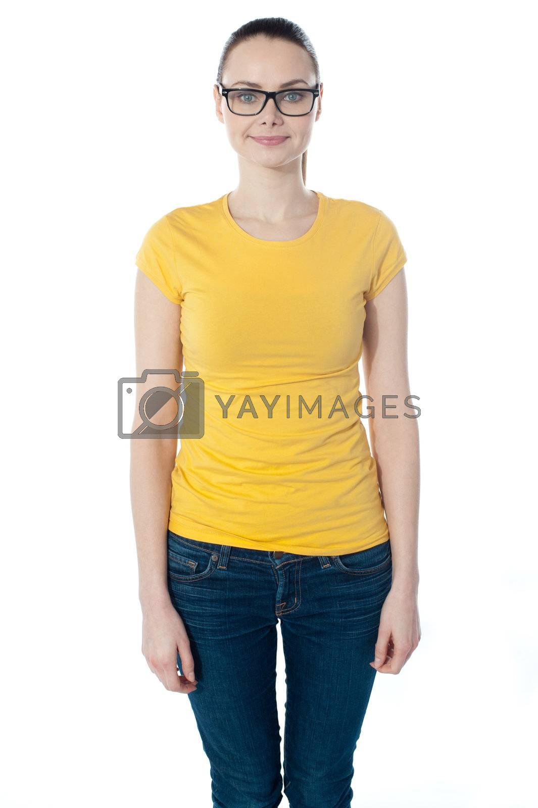 Smiling young woman in glasses posing over white background